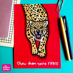 leopard print on red background with the text show them you are fierce at bottom